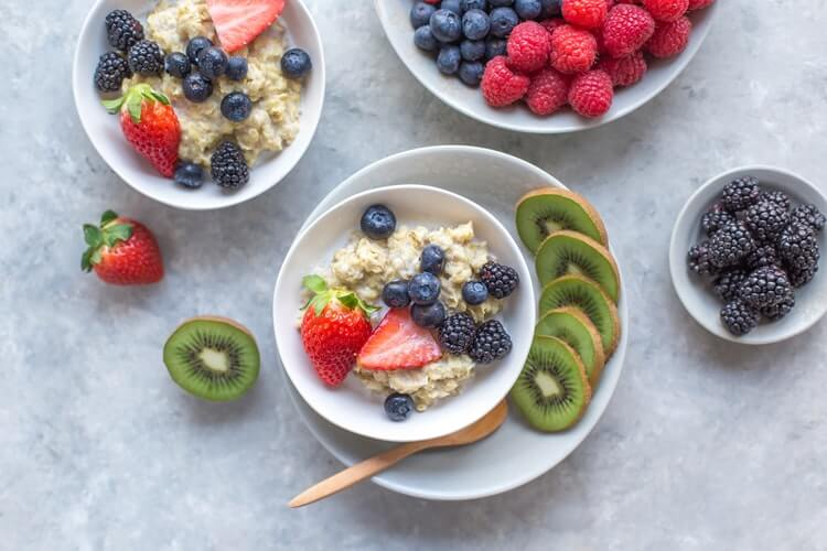 assorted fruits in oats bowls which is said good for weight loss