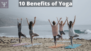 women doing yoga in a beach