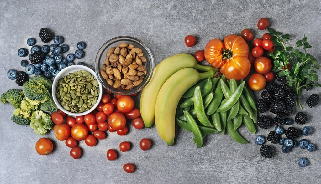 low-carb diet food including vegetables, fruits, nuts kept on a table