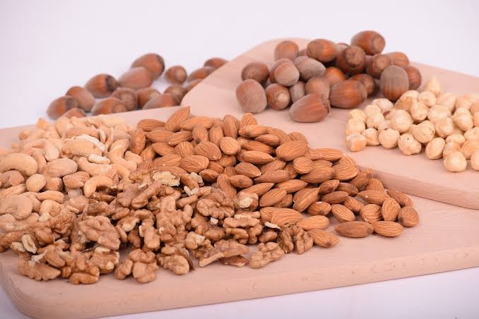 nuts and seeds on brown plate