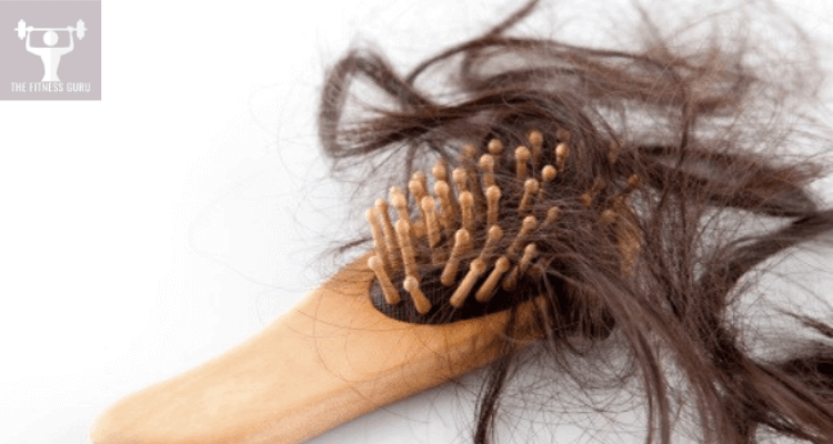 hair brush with lots of broken hair